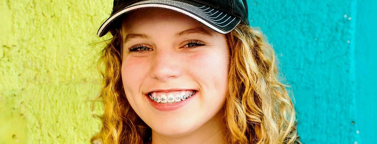 Teenage girl wearing fixed braces
