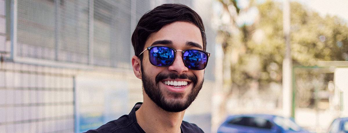 Young man smiling in sunglasses